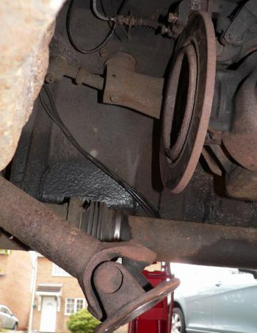 Half shaft removed from brake disc