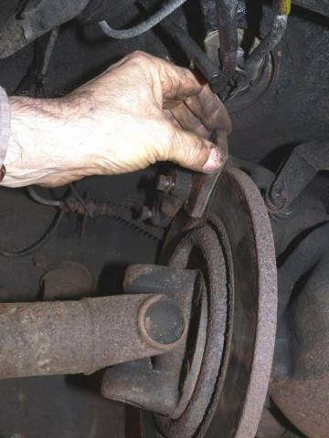 Remove outer brake pad